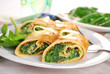 rolled spinach pancakes cut into small pieces