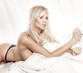 Beauty portrait of blonde woman lying.