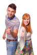 Smiling couple give thumbs up