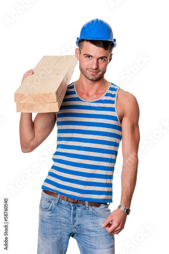 smiling carpenter holding planks
