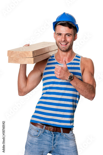 smiling carpenter gives thumbs up