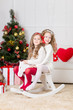Cute girls playing  in Christmas decorated room