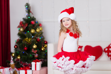 Christmas portrait of beautiful curly girl