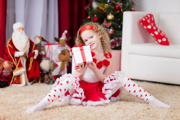 Beautiful curly girl with Christmas giftbox