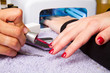 manicure and Hands with uv lamp for nails
