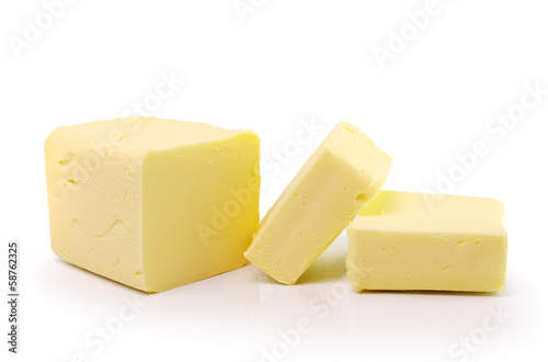 Staande foto Zuivelproducten Stick of butter, cut, isolated on white.