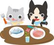 食事をする猫と犬
