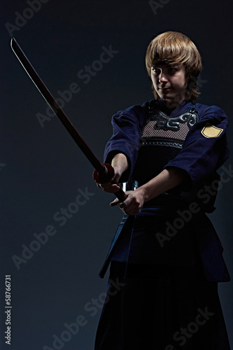 portrait of a kendo fighter with bokken