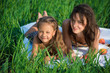 Happy girls on green grass