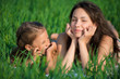 Happy girls on green grass