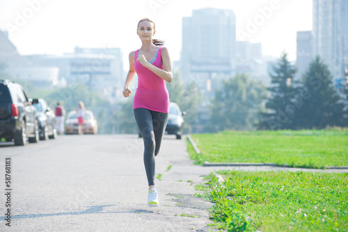 Jogging woman running in city park