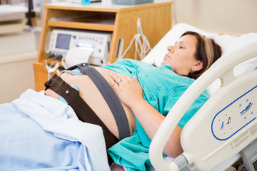 Birthing Woman with Electronic Fetal Monitor Attached