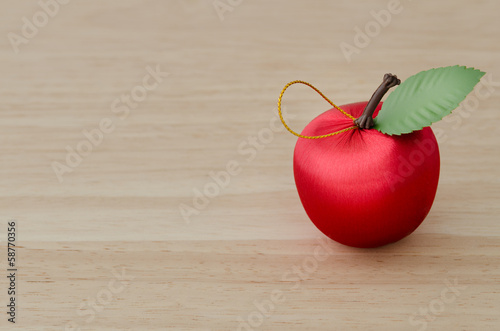 Fake red Cherry on Wood