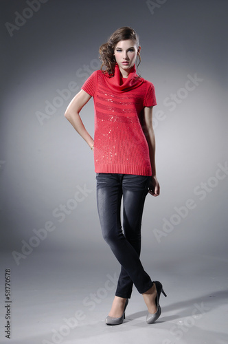 Full length fashionable woman in fashion red dress posing