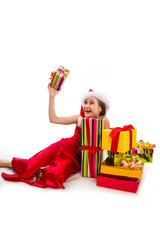 Christmas gifts and small girl Santa
