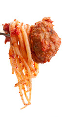 spaghetti with  meatball in tomato sauce on a fork