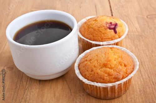 muffins with coffee on wooden table