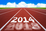 New Year 2014 on running track concept with blue sky