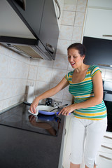 Woman cleaning induction stove