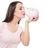 Woman kissing piggy bank