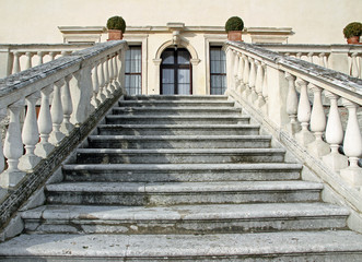 stone steps leading to the entrance of the prestigious Italian V