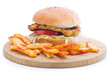 Vegetarian burger on wooden plate with french fries
