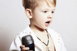 little boy singing in microphone.child in karaoke.rock music