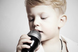 little boy singing in microphone.child in karaoke.music