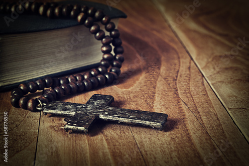 The iron cross on a wooden surface closeup