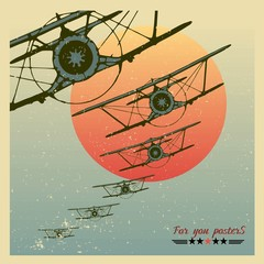 Vintage Planes dive against the evening sun