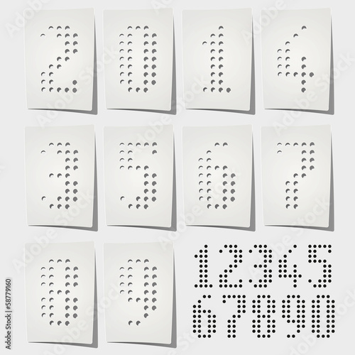 Dotted numbers punched on white paper