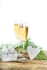 Christmas champagne with silver present on wooden background