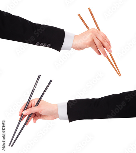Businessman's hand Holding Chopsticks