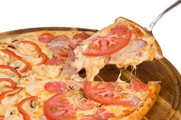 pizza with salami ham pepper and tomato on wooden plate