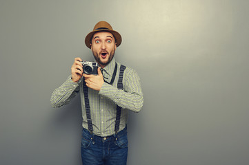 amazed young man with camera