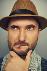 pensive hipster man over grey