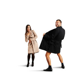 woman looking at crazy man in coat