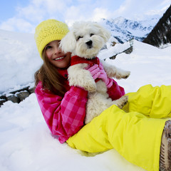 Winter, child, snow - girl with dog enjoying winter