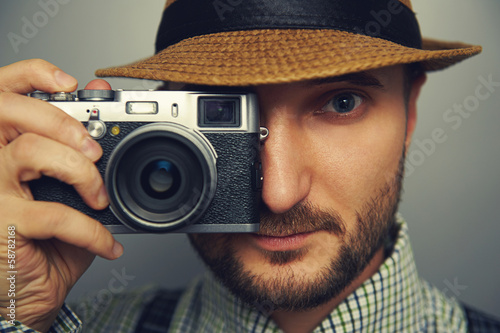 stylish handsome man with camera