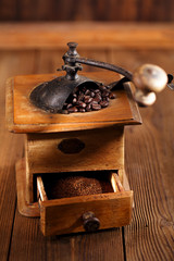 Old coffee mill with coffee beans, close-up