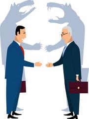 Deceiving businessmen shaking hands