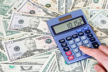 Dollar bills and calculator