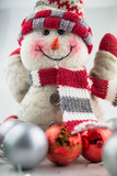 Christmas and New Year snowman with toys