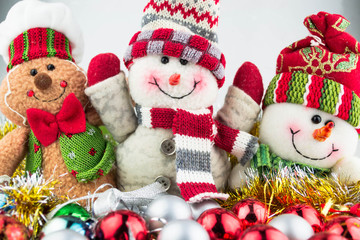 Christmas and New Year snowmen with toys