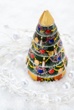 Vintage wooden Christmas tree on light background