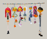 Six female and one male handmade isolated thin dolls toys in fas
