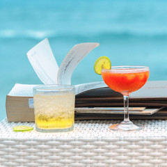 two coctails on beach .
