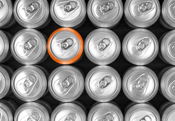 aluminum drink cans and one orange can. Difference concept