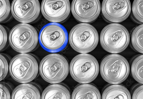 Aluminum drink cans and one blue can. Difference concept