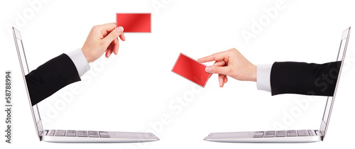 hand holding card with laptop